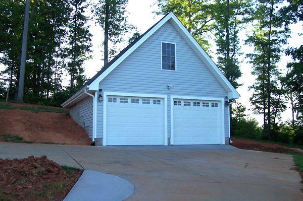 2 car garage with bonus room built into a hillside our for Hillside garage plans
