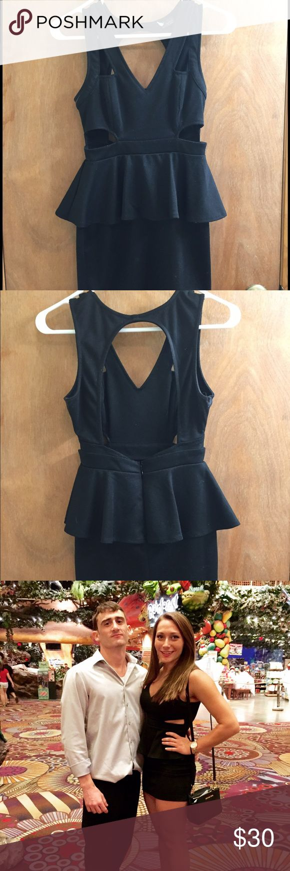 Urban outfitters black peplum dress with open back Gently worn short black peplum dress with cutouts and an open back Urban Outfitters Dresses Mini