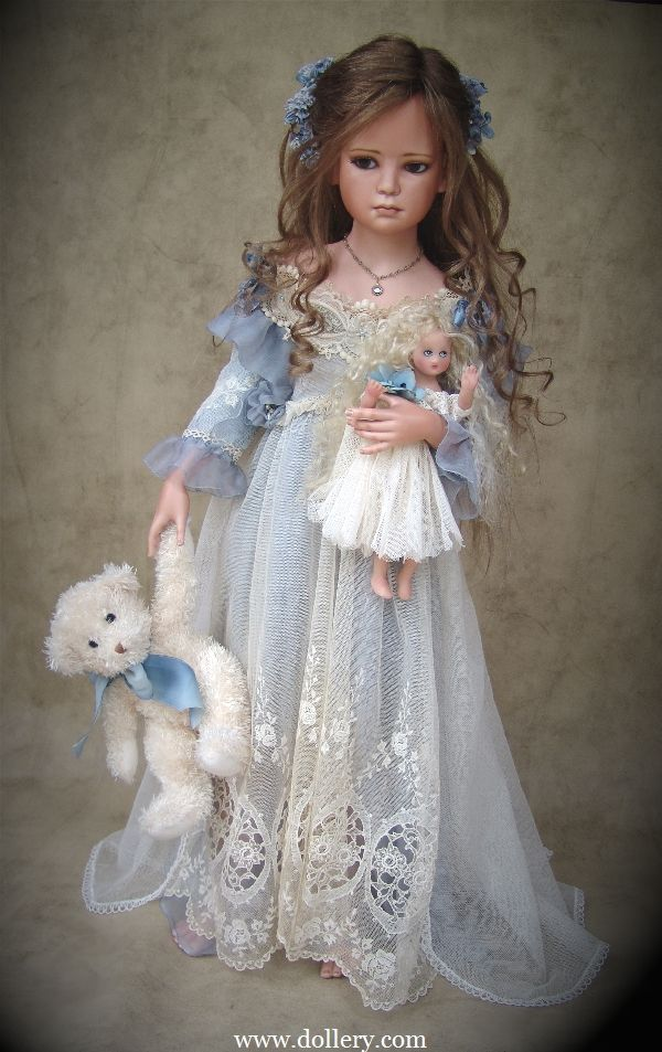 Francirek-Oliveira 2006.  GRS says:  With a little doll and teddy bear of her own!  How sweet