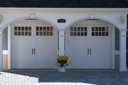 traditional dual single #garage doors with #arches