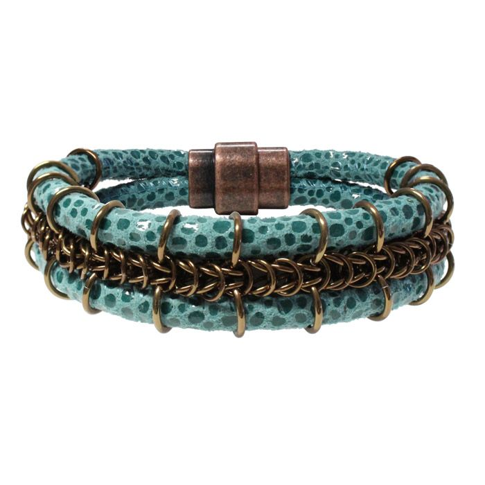 Cord-ially Yours Bracelet features queen's braid chainmail nestled between suede leather cord and finished with a stylish magnetic clasp. The cord is 5mm stitched suede round leather cord made by Leather Cord USA. The queen's braid chainmail is made with anodized aluminum jump rings. The bronze rings of the chainmail contrasts nicely with the turquoise pebble-print cord to create an attention-getting bracelet.