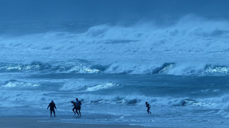 Big, wind-whipped surf, Karridene Beach, south of Durban, South Africa 2012, and a family really enjoying the shallow bits!
