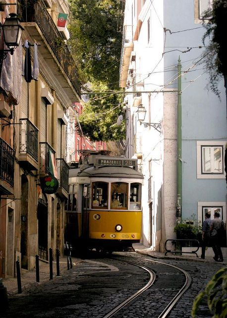 Look how close the tram is to the buildings.  Lisbon, Portugal