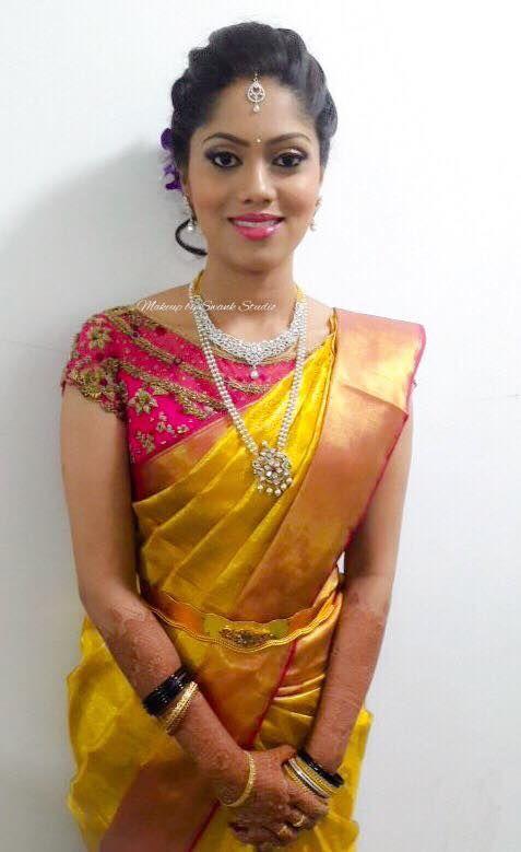 Shrutha looks elegant and flawless for her reception. Makeup and hairstyle by Vejetha for Swank Studio. Pink lips. Bridal jewelry. Bridal hair. Silk sari. Bridal Saree Blouse Design. Indian Bridal Makeup. Indian Bride. Diamond Jewellery. Statement Blouse. Tamil bride. Telugu bride. Kannada bride. Hindu bride. Malayalee bride. Find us at https://www.facebook.com/SwankStudioBangalore