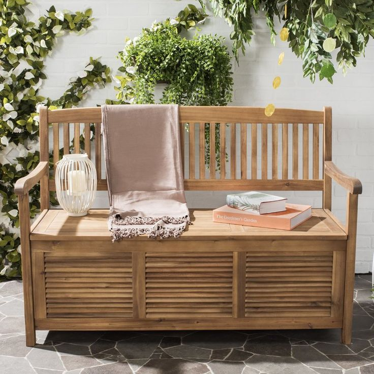 Pairing a slated design with a weathered finish, this garden bench is as versatile as it is stylish. Set it in your sunroom to rest your afternoon tea, let it display a potted amaryllis in the sunroom, or top it with a stack of fluffy towels in the guest bath.