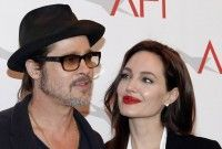 Actor Brad Pitt and actress/director Angelina Jolie pose at the AFI Awards 2014 honoring excellence in film and television in Beverly Hills