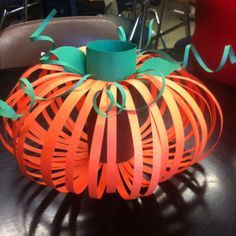 Pumpkin made from a toilet paper roll and construction paper as a Thanksgiving craft for the 4th graders.