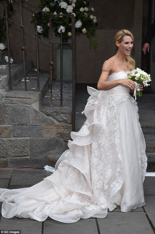 Glam:The blonde beauty, who is pregnant, tied the knot at Palazzo della Ragione in Bergam...