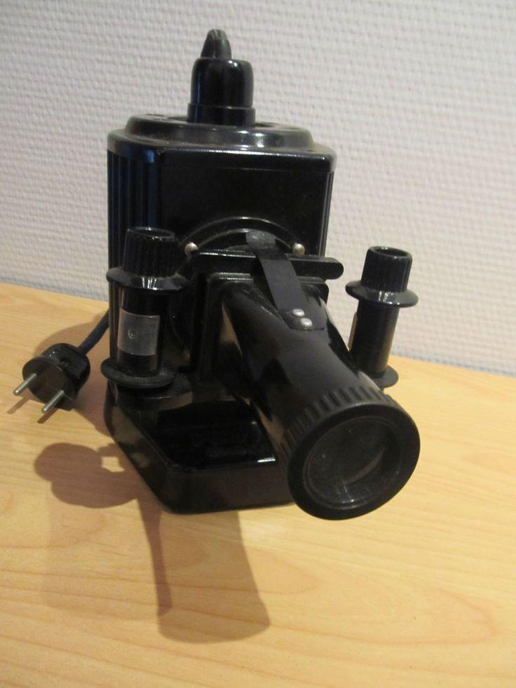 DDR Projektor  POUVA Magica - Bakkalit mit 6 DEFA- Filmrollen