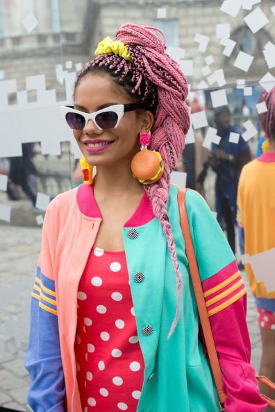 Fashion Blogger Maga Moura is wearing a vintage jacket Forever 21 dress and Bitsch Kitsch earrings on day 2 of London Collections Women on September...