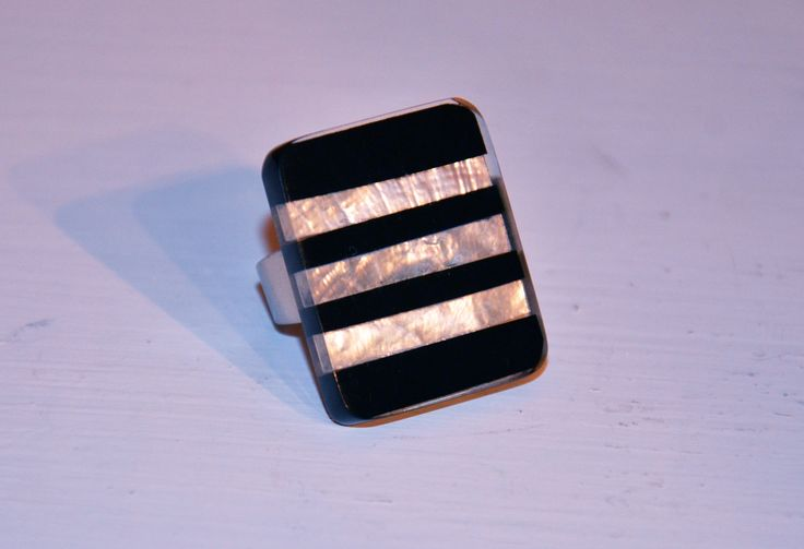 Black and white striped resin ring perfect for all occasions. Available at www.ciaobella.ca
