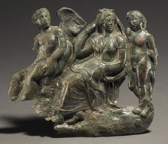 GREEK BRONZE MIRROR COVER WITH APHRODITE, EROS, & THANATOS In high relief. The mirror with it is Roman. Ca. 375-350 BC