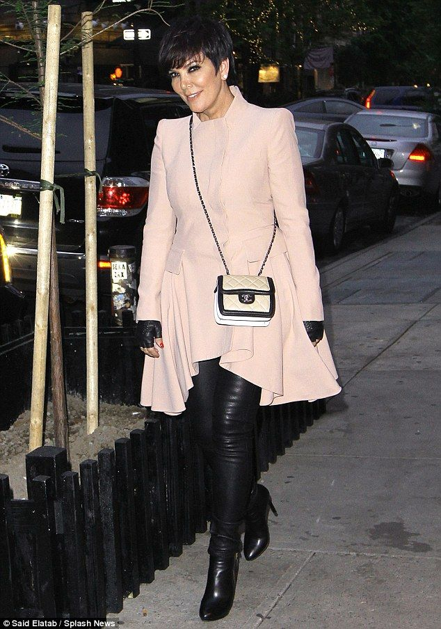 Pretty in pink: Kris Jenner was stylish in her flaring pink coat, black leather trousers and leather mitts