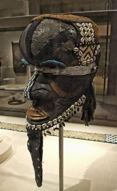 Africa | Mask (Bwoom) Kuba Western Kasai region Democratic Republic of Congo Late 19th - mid-20th century Wood metal glass beads, fabric pigment seeds string and leather | Photographed at the Art Institute of Chicago, Chicago, Illinois.