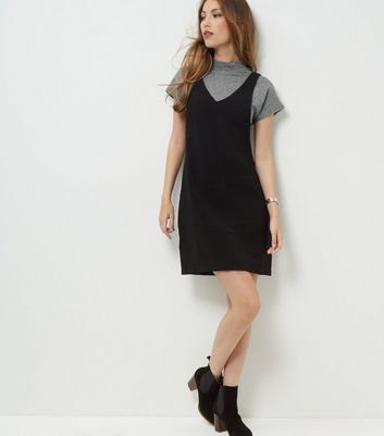 Tall. Bring pinafore designs into your everyday look with this black textured number. Wear over a grey tee and finish with block heel ankle boots.- Textured finish- V neckline- Sleeveless design- Zip back fastening- Casual fit that is true to size- Mini length- Model wears UK 10/EU 38/US 6 Tall size guide:UK size 8: Bust - 84cm, Waist - 66cm, Hips - 90cmUK size 10: Bust - 88cm, Waist - 70cm, Hips - 94cmUK size 12: Bust - 93cm, Waist - 75cm, Hips - 99cm UK size 14: Bust - 98cm, Waist - 80cm…