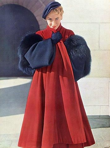 The bold, elegant pairing of strawberry and navy blue as crafted by Christian Dior. 1950s