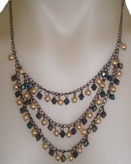 Great art deco stylings in this gorgeous faux pearl and blue tone bead necklace. Currently at a great reduced price to sell to make way for new arrivals.  Snap one up for yourself and another for your bestie!