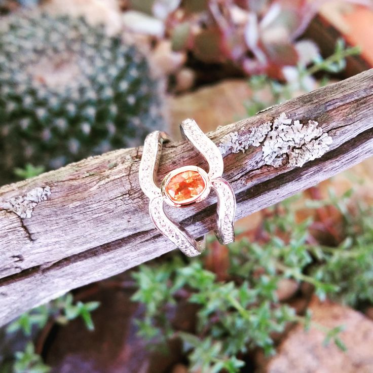 Adorned By Sally Sterling silver and rose gold ring set with zirconia's and an orange Garnet $320