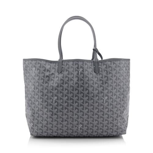 An iconic Goyard tote in grey Goyardine canvas with tonal leather trim and silver-tone hardware. Details include double leather handles, a spacious beige canvas interior, and detachable pochette. The St. Louis PM is the smallest size of the design.
