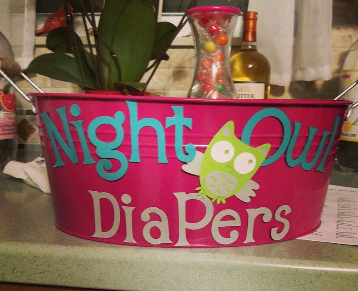 Guests write cute or motivational sayings on diapers. The parents use these diapers in the middle of the night. Owl themed baby shower!