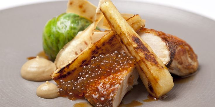 Poached and roasted pheasant with Savoy cabbage, roast parsnips and sherry vinegar pearls