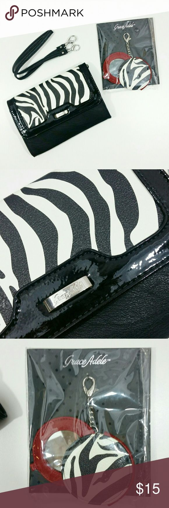 Grace Adele clutch with mirror This Grace Adele clutch is red, black, and zebra print. It comes with a clip on pocket mirror and a detachable strap that is approx 23 inches. The purse is 6 inches long and 8 1/2 inches wide. Grace Adele Accessories