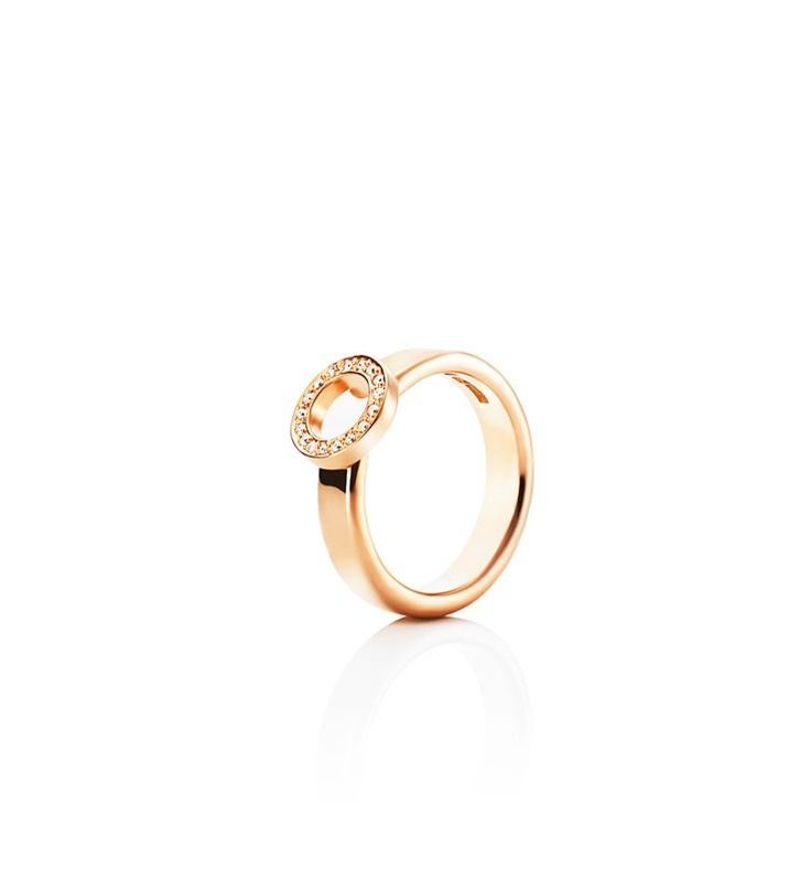 Efva Attling - Ring On Ring - $2,595. Gold or white gold ring with a small ring on top set with diamonds.