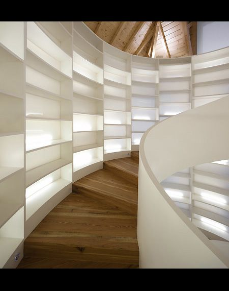 I need one of these bookshelf staircases for all my books...  It would also need to go up quite a few floors too!