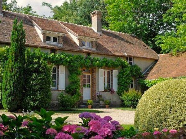 Casa de campo de estilo cottage, inspirada en la campiña                                                                                                                                                                                 Más