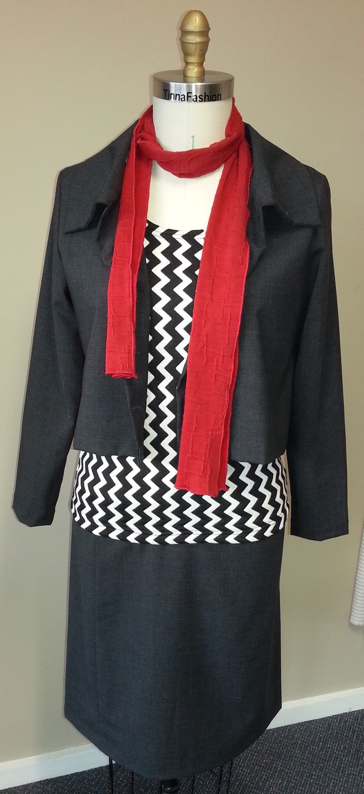 Classic Knit Top in Kitchy Jacquard fabric, a Short Jacket and matching Paneled Skirt in Charcoal Wool Blend, and a scarf in Red Warrior Knit