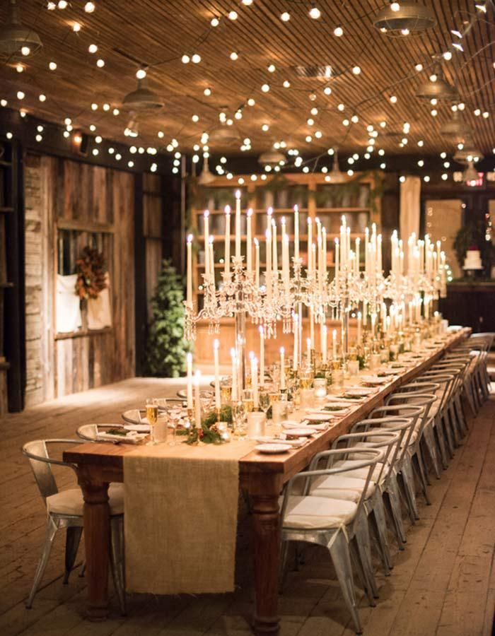 Winter Wedding at Terrain at Styer's indoor setting, lights hanging & table  setup; dont like candlesticks