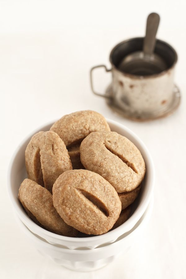 Biscotti al cafe  230 g flour   160 g butter  120 g sugar  2 tsp espresso+1tbs instant coffee    Cream butter with sugar  Add coffee and then add flour.  Knead the dough, form a ball and let rest in fridge 2 hrs  form into balls, size of walnuts, but oval, slightly flattened  Arrange on a baking sheet w parchment paper  cut a vertical cut  Cook at 170 degrees for 15 minutes (for me 20)  Let cool, store in a tin box