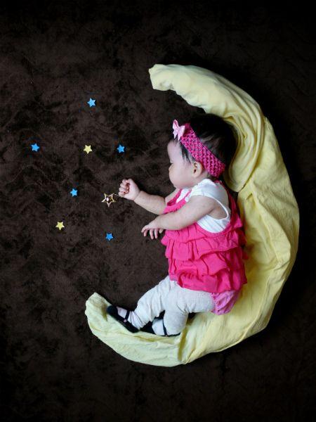 Sleeping baby wishing on a star