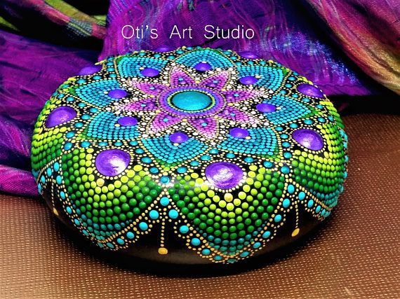 Mandala Stone- Hand Painted This precious stone was created with much love and joy. The mandala stones have in them many hours of joyful work and prayer for the owner to feel the vibration of joy, happiness and worth of our beautiful Universe. Size: 8.5cm.in diameter = 3.35inch. The