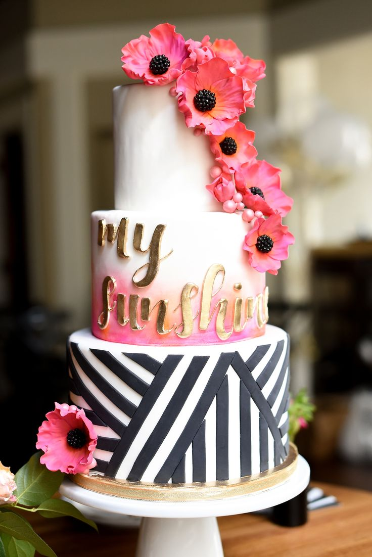 Modern pink and orange wedding ideas with black and white striped cake, gold lettering, and anemone gumpaste flowers. Photos by Mikkel Paige photography, planning by Ashton Events and Every Last Detail.