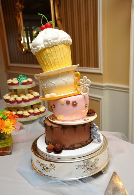 tumberling alice in wonderland styled tiered wedding cake