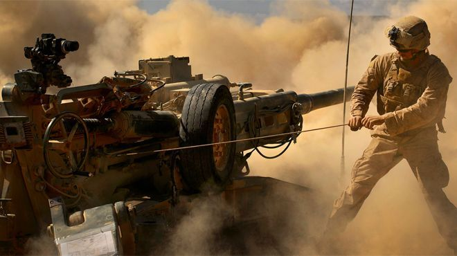 November 3, 2013: A Marine with the 13th Marine Expeditionary Unit, Battalion Landing Team 1/4, fires the M777 howitzer during a battery def...
