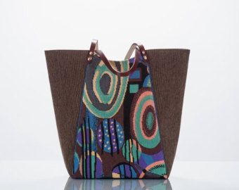 This Eco Fashion bag is one-of-a-kind; built to carry a large and heavy load. Materials:  Upcycled ikat denim jeans and lace-up-the-side vintage
