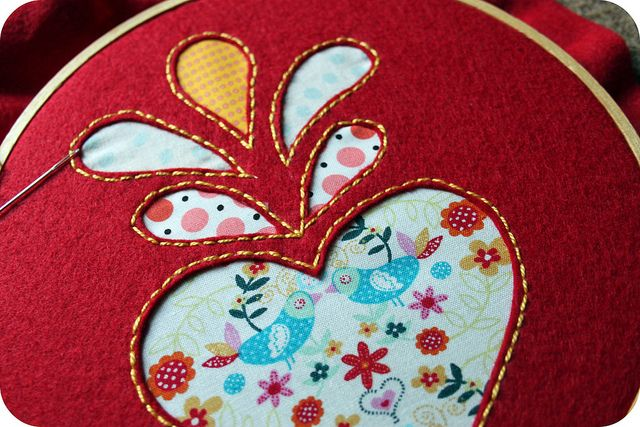 reverse applique with felt & fabric. Felt is easier to cut than other fabrics and doesn't fray, lovely effect!