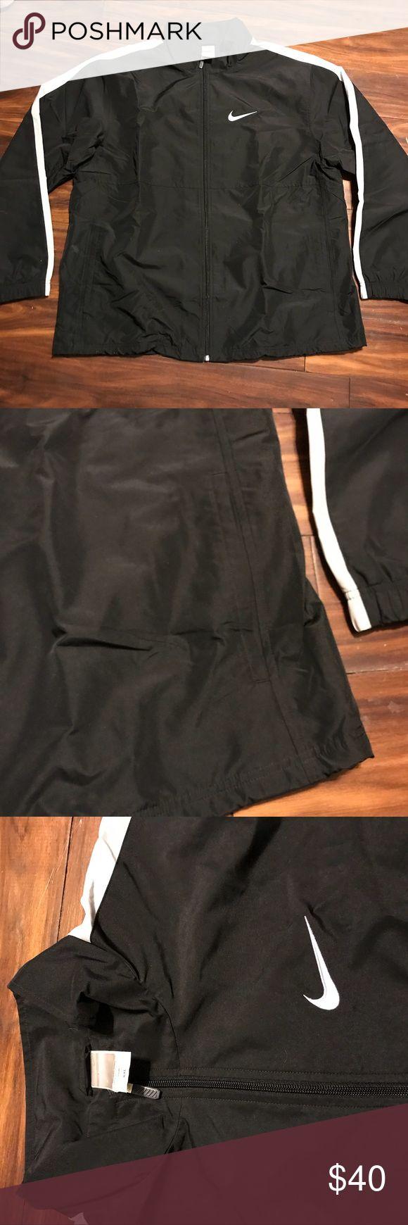 Men's Nike Jacket Black men's Nike waterproof rain coat with white trim. Has pockets.  Men's size XXL, can also fit a women's size 2X. Nike Jackets & Coats