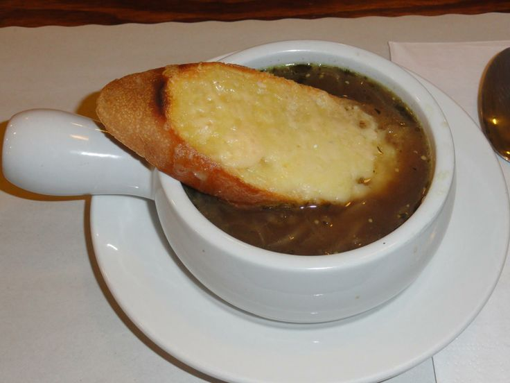 Made with Gruyere Cheese, French cognac, and Dijon mustard: the way an authentic French Onion Soup should be - at Savoury and Sweet Restaurant Niagara Falls