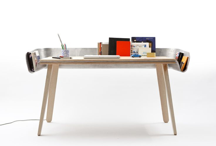 HOMEWORK - a work table with an aluminium cloth folded on the wooden table to provide an extension for storing books or other objects