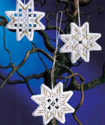 "Create three lovely 3"" Hardanger snowflakes with this complete kit from Permin Scandinavian Art Needlework.   The kit contains 22-count White Hardanger fabric, 100% cotton thread, gold accent thread, needle, chart and instructions."