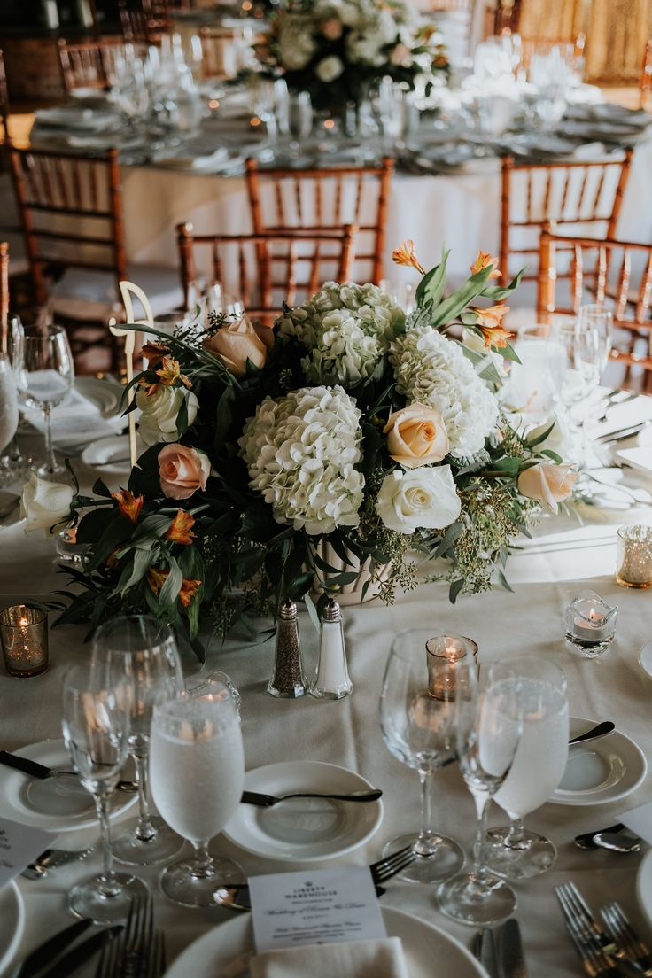 White hydranga and coral rose centrepiece; Liberty Warehouse wedding in Brooklyn NY; PHOTOGRAPHY Joel + Justyna Bedford