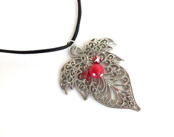 This intricate leaf pendant is so elegant and pretty! The leaf itself measures a little over 2 1/2 inches long. I wanted to add a pop of color, so I used a cherry red agate bead and shimmery red crystals. I used a lightweight leather cord for the necklace, measuring 23 inches