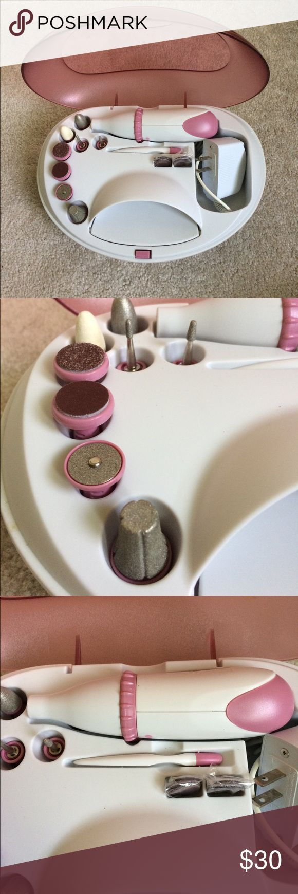 NWOT manicure kit new without tags! never been used! complete manicure kit.   Corded mani/pedi tool comes with a variety of attachments. ncludes a polishing disk for buffing and smoothing nails; fine, medium and coarse filing disks; pointed thin cone for filing the edge of nails; rounded cone filer for thicker nails; cleaning brush; built-in nail dryer; and replacement pads.   Low and high speed settings Nail dryer and mani/pedi tool charge via an included AC adapter Accessories