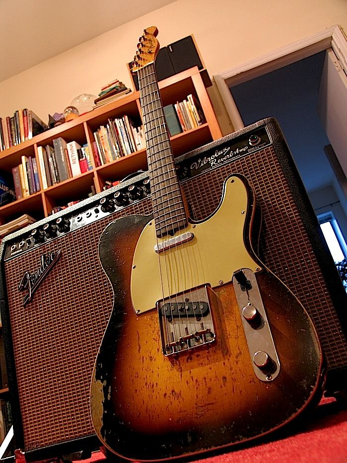 1960 Fender Telecaster Custom in sunburst with a Fender Vibrolux Reverb amp. The Vibrolux Reverb was a 35watt 6L6 amplifier featuring two 10 inches speakers characterized by a sparkling tone with an early breakup. ~Matt