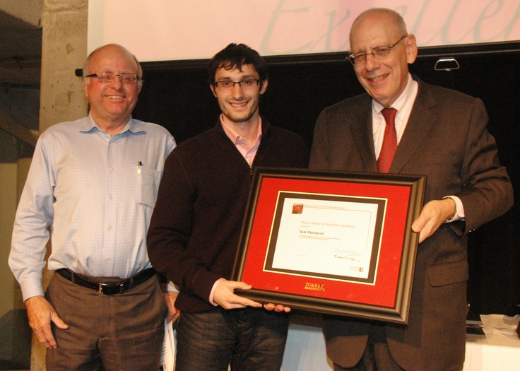 Sam Presvelos, winner of the Dean's Award for Academic Excellence, with Associate Dean Gary Spraakman, left, and Dean Martin Singer.