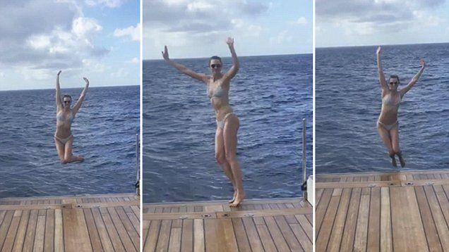'Jumping into 2017 like': Bikini babe Karlie Kloss leaps into the Ocean in St Barths. Karlie created a looping gif of her self in a grey bikini making the instagram famous jump.