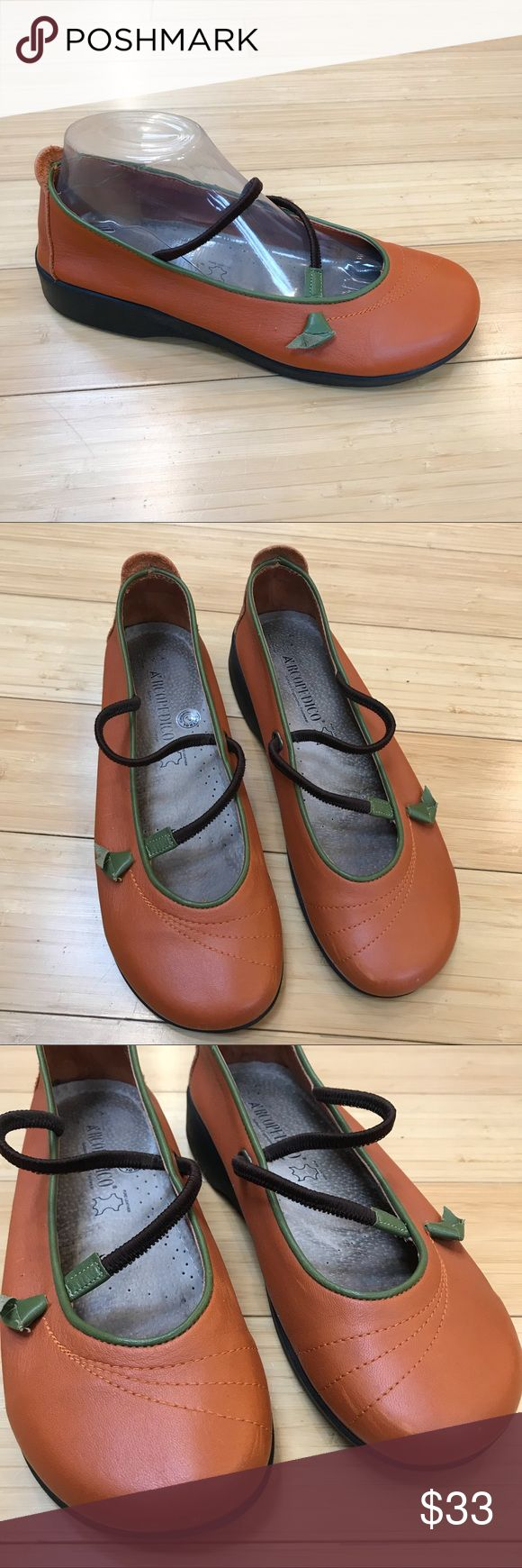 Arcopedico soft leather mary-jane style flats, 39. Beautiful pair of soft burnt orange and green flats by Arcopedico, size 39. I feel these best fit a size 8.5, and I am listing them as such. Elastic tops, small tie on the side that resembles a leaf. Shoes are in excellent condition, save one small scuff on the left toe. Bottoms are great, inside foot bed is dirty looking from wear. Outsides are soft and show almost no wear. Really nice! Arcopedico Shoes Flats & Loafers